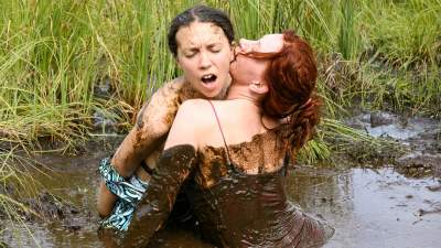 Nude girl masturbating with mud
